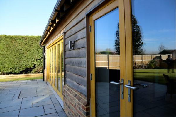 bifold patio doors and wooden french doors
